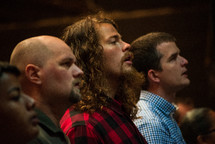men singing during a worship service