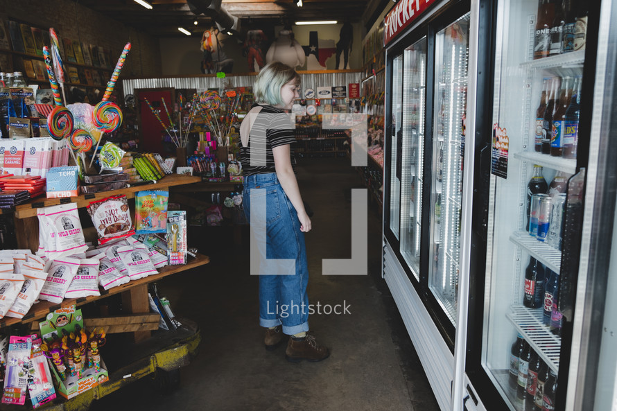 a woman shopping at a candy shop