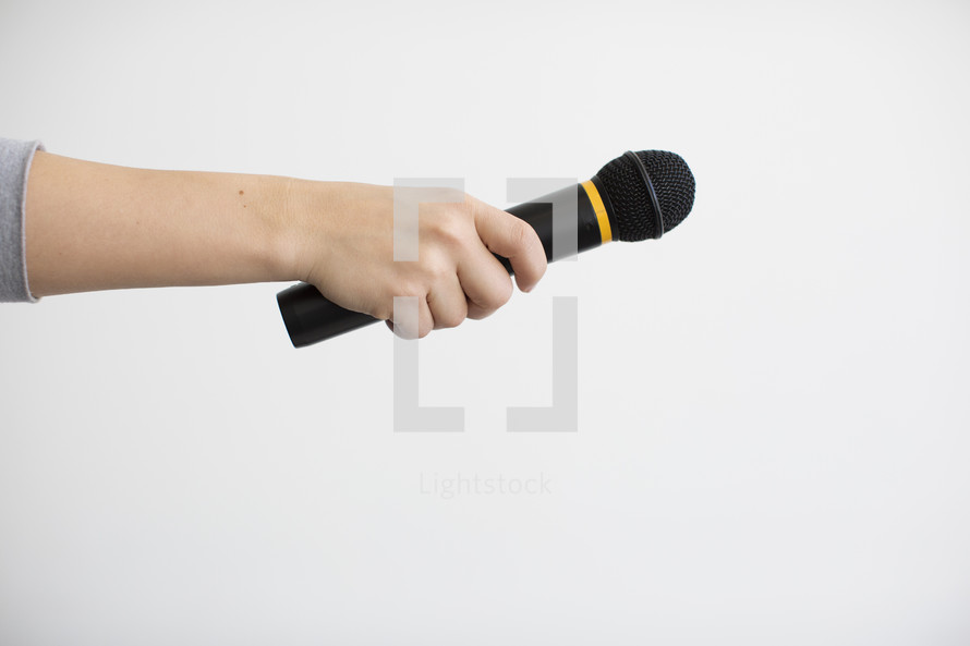 arm holding out a microphone