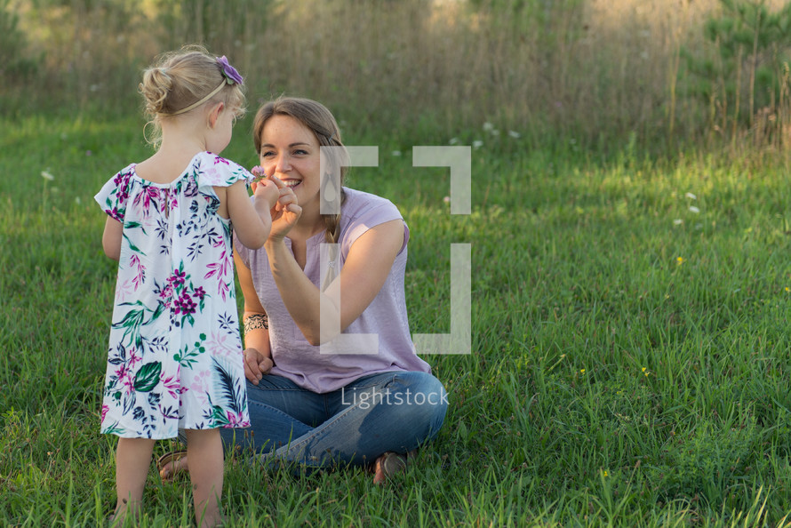 mother and daughter picking flowers