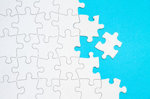 Seperated puzzle piece on blue