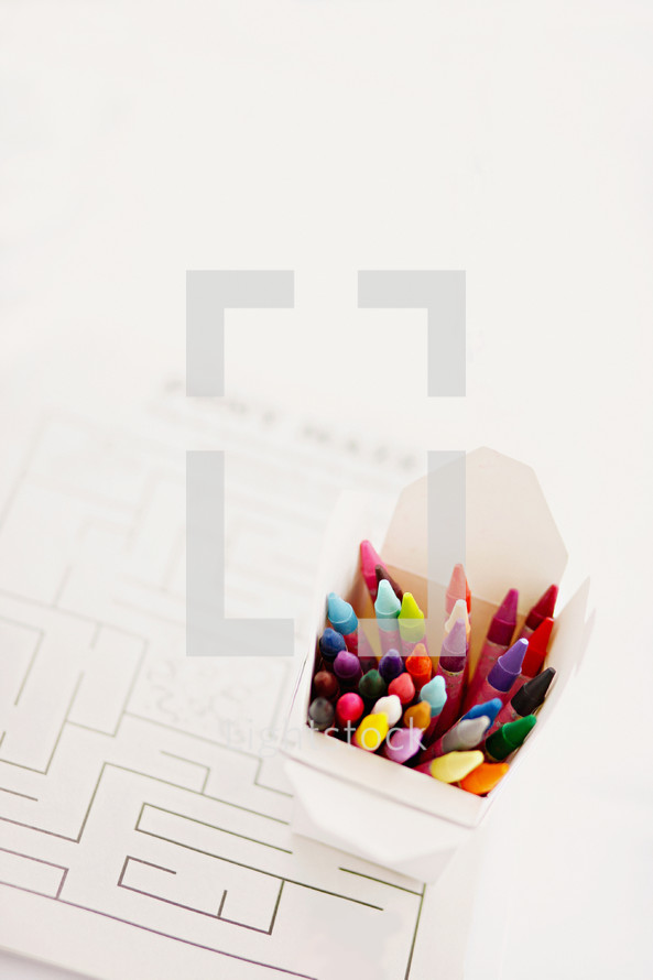 box of crayons and paper maze