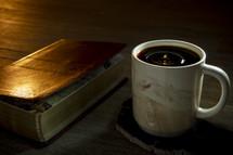 cover of a Bible and coffee mug