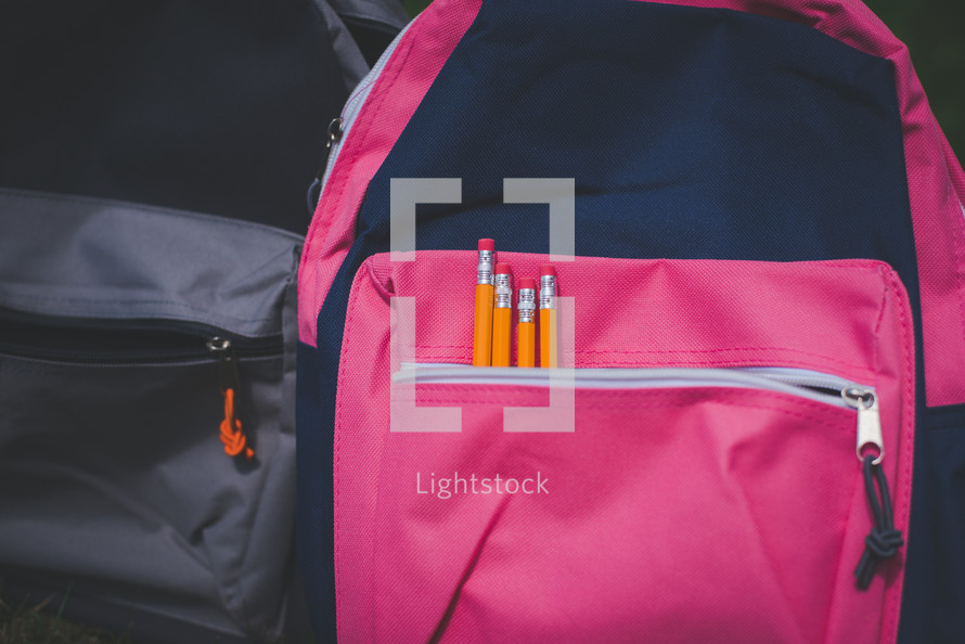 Book bags with pencils in the pocket, ready for back to school or school