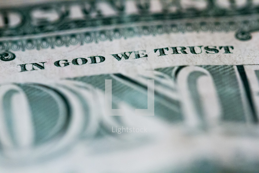 one dollar bill with In God We Trust