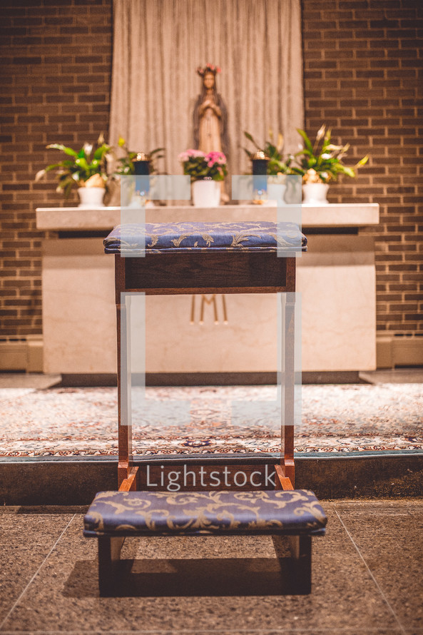 kneeling bench in front of an altar