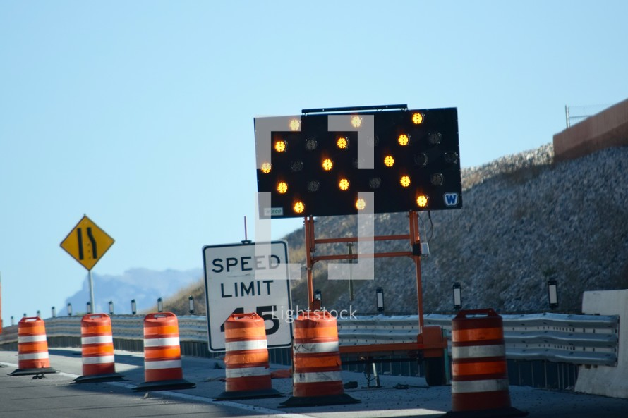 traffic cones on a road under construction