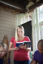 woman reading a Bible to a small group