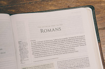 Bible opened to Romans