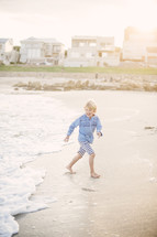 boy child running on a beach