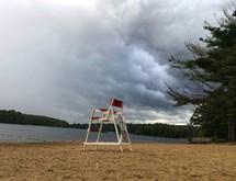 lifeguard chair on a lake shore