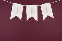 joy banner on maroon