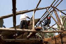 building rustic homes in Rwanda