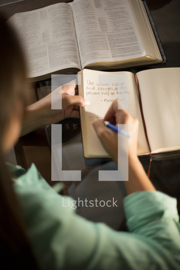 Man reading bible and taking notes