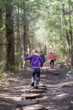 children exploring a nature trail