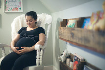 a pregnant woman holding her belly