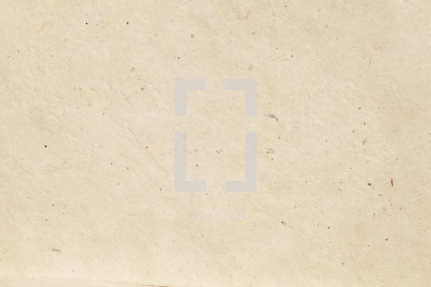 textured paper background.