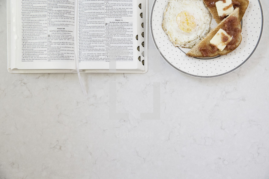 breakfast and morning devotional with open Bible on the table