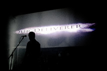 silhouette of a man on stage - our deliverer