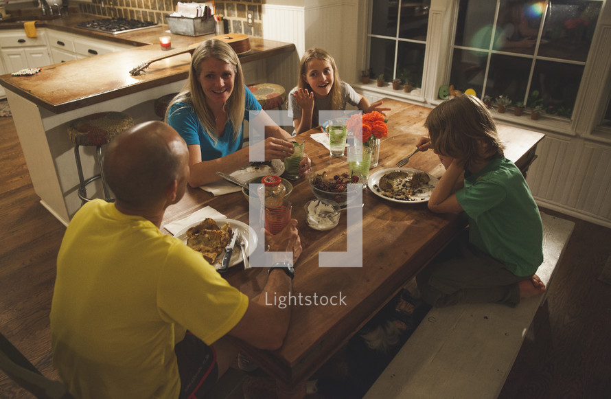 A family having dinner together.
