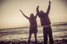 couple with raised hands - worship to God