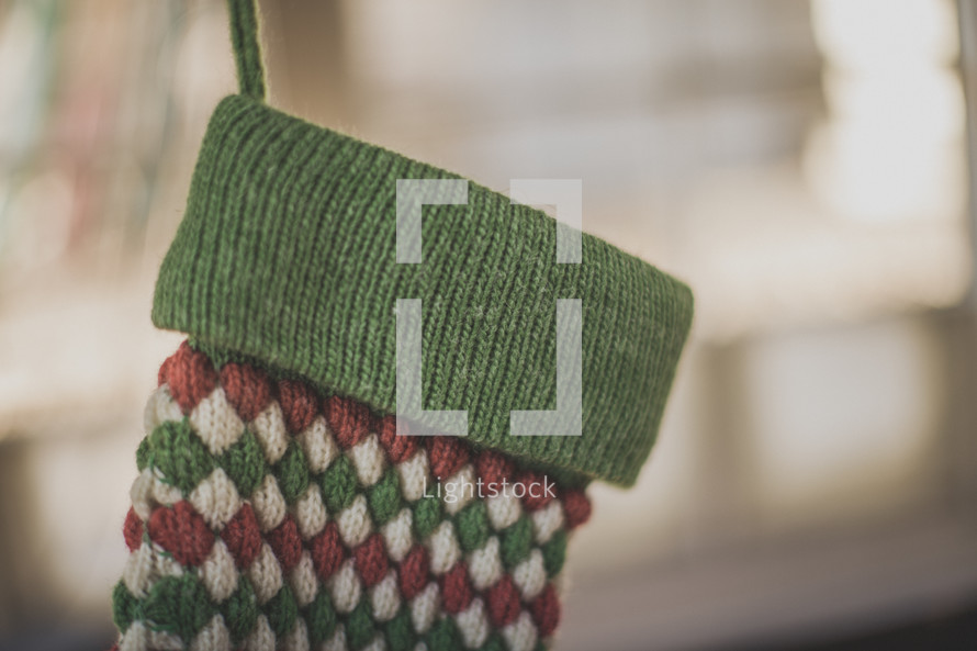 A red and green stocking hanging