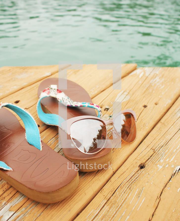 flip flops on a pier
