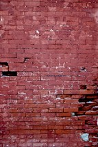 broken bricks in a red brick wall