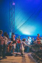 praising God and kneeling in prayer at a worship service