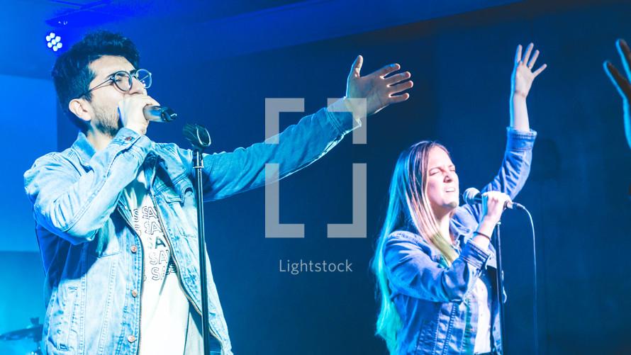 worship leaders singing during a worship service
