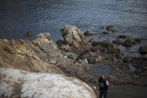 man standing on a rocky shore