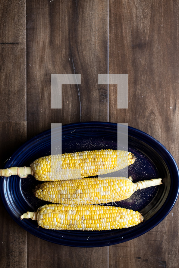 corn on the cob on a plate
