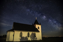 small rural church under stars in the night sky