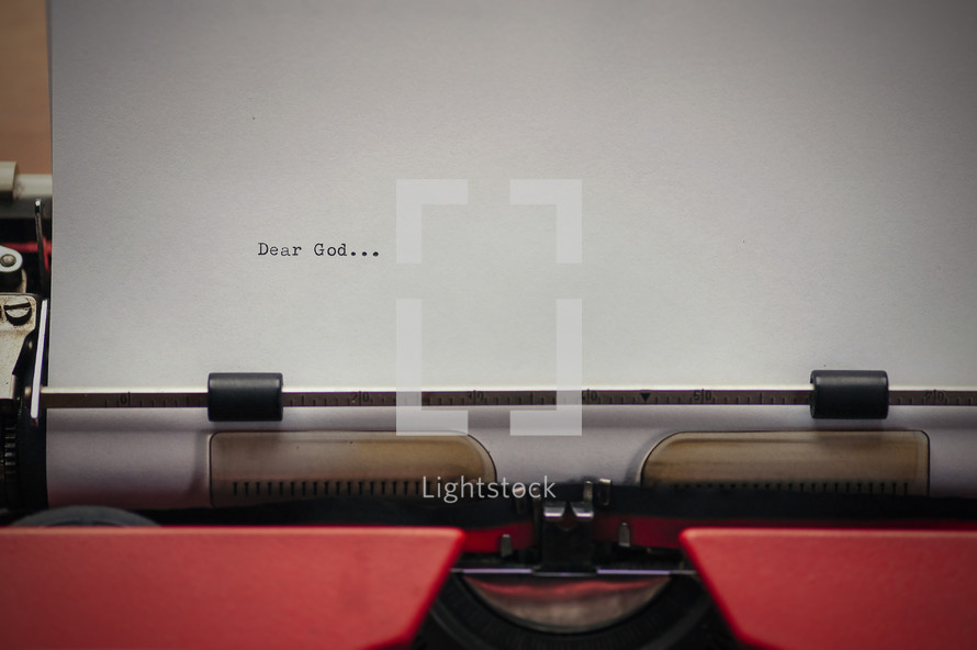 Letter to God on a typewriter. The start of a prayer...
