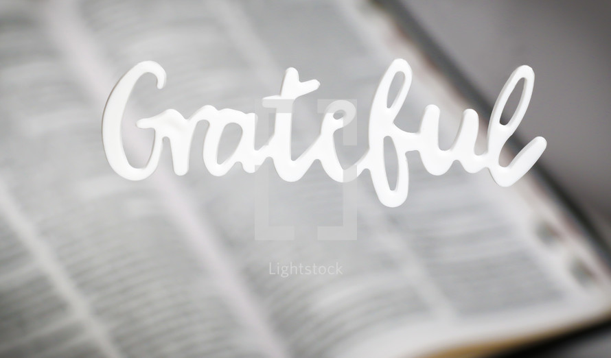 word grateful over an open Bible