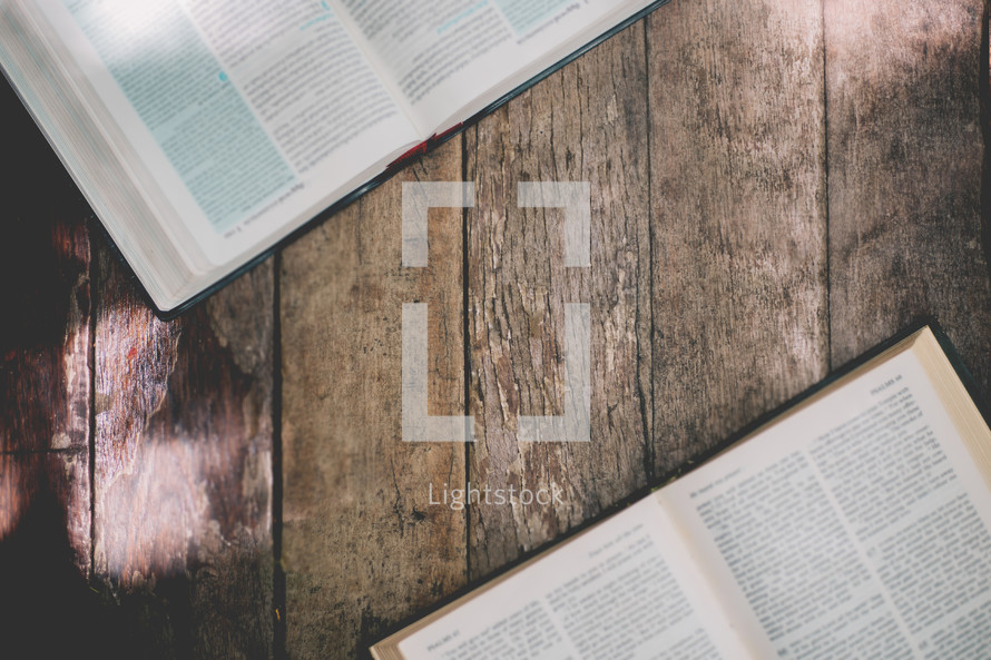 open Bibles on a wood background