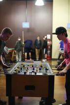 teen boys playing fuse ball