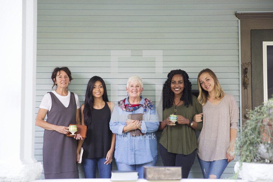 women standing together on a porch before a Bible study