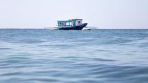 shrimp boat on water