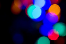 colorful bokeh lights in darkness