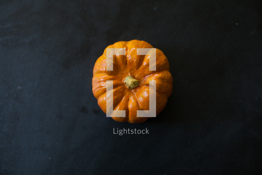 mini pumpkin in the center