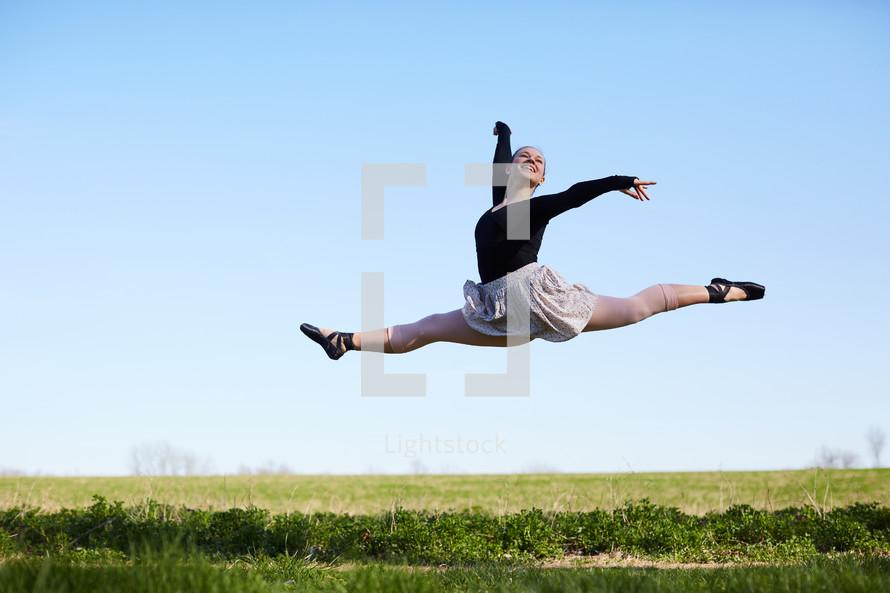 a ballet dancer in a field