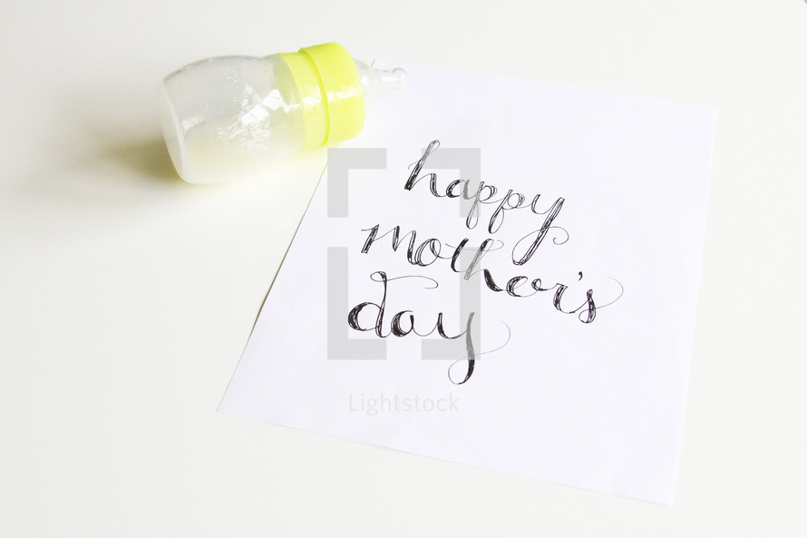 baby bottle and Happy Mother's day sign