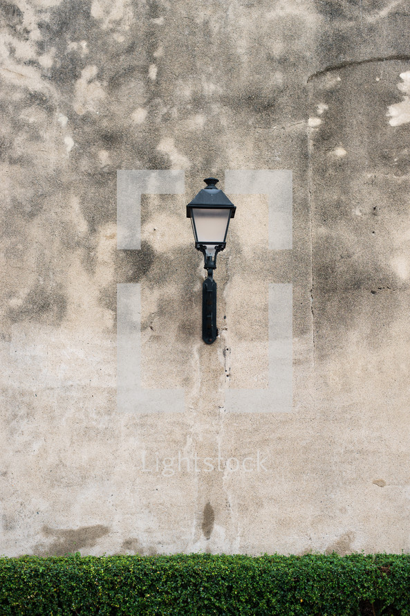 lamp on a concrete wall