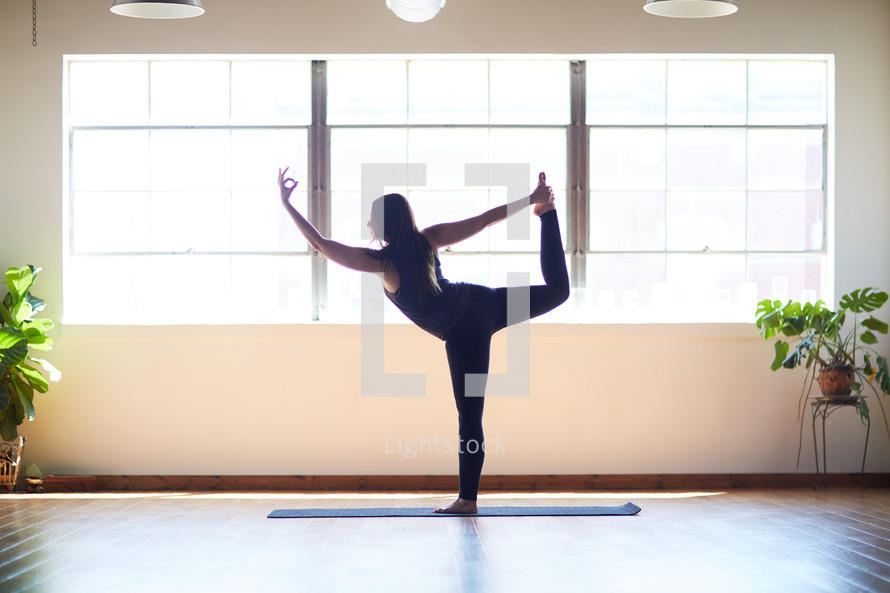woman stretching in a yoga studio