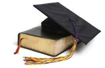 graduation cap and a Bible
