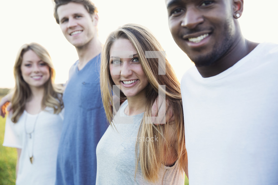 smiling faces of a group of young adults