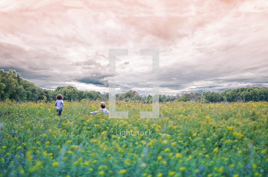 children running in a meadow
