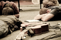Musicians in a prayer circle on the floor.