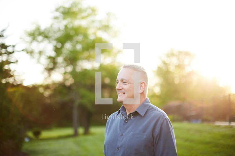 headshot of a man standing outdoors